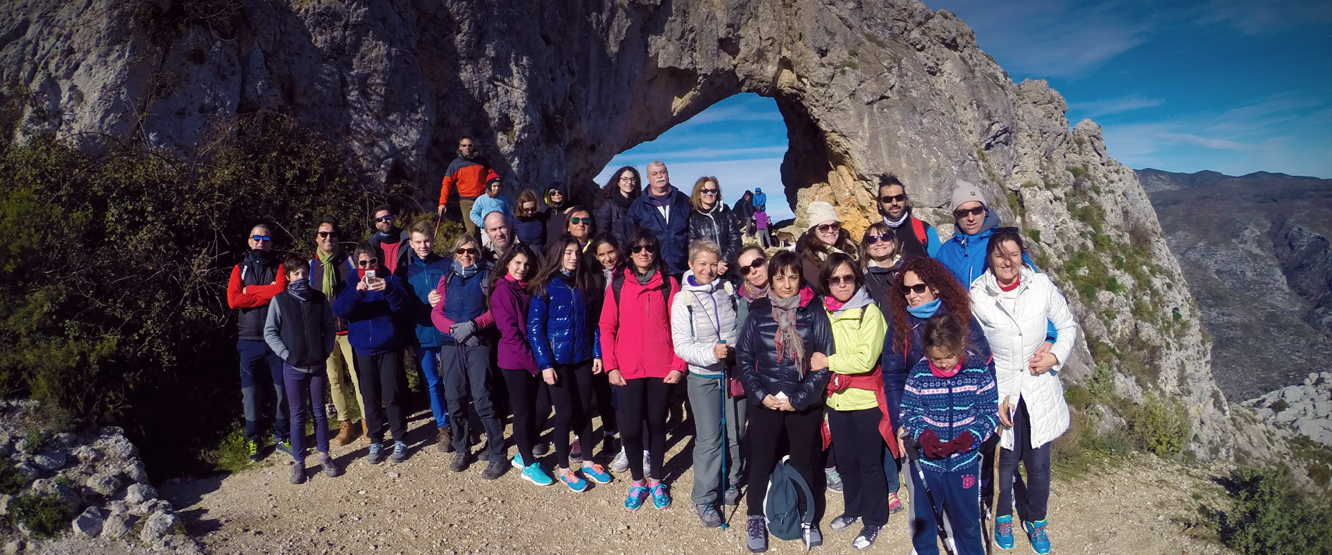 Group of walkers in valley of Gallinera